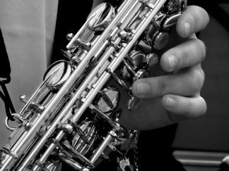 """""""A Lullaby for Lester"""" by Daniel Kallman for chamber wind ensemble (gr. 3) with solo tenor sax (gr. 1)."""